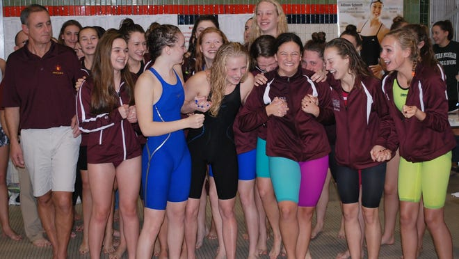 Birmingham Seaholm celebrates winning the Div. 2 title as the standings are announced Saturday at EMU.