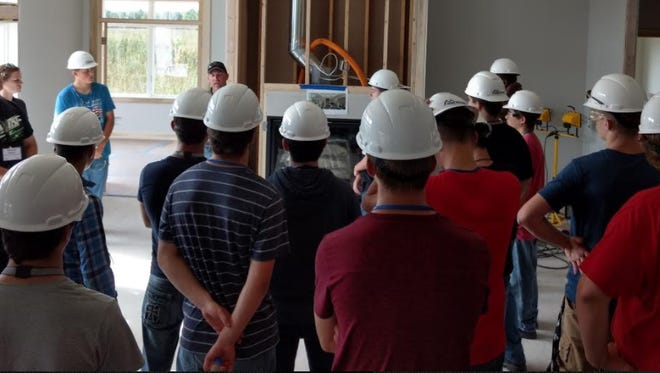 """Two Rivers High School juniors and seniors participated Sept. 21 in the """"Made Here Bus Tour 2017"""" sponsored by The Chamber of Manitowoc County. Pictured are students on a home construction site during the tour."""