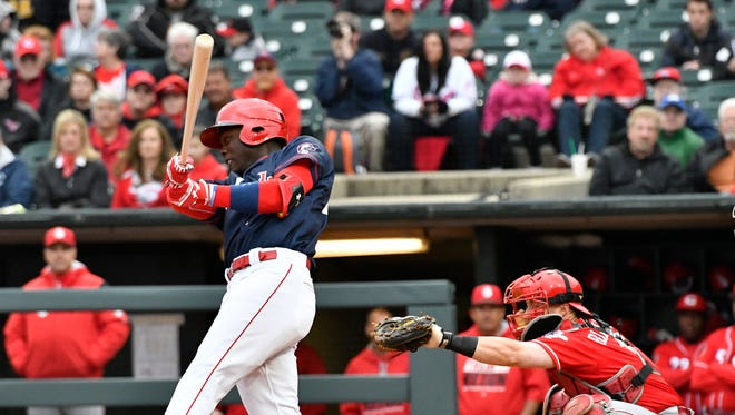 Louisville's Aristides Aquino connects on a pitch for a home run against the Reds on Friday.