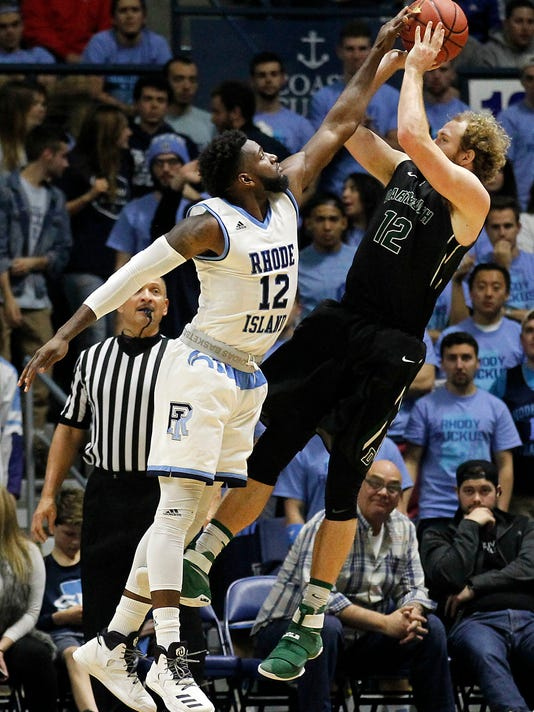 Rhode Island's Hassan Martin (12) blocks a shot by Dartmouth's Evan Boudreaux (12) during the second half of an NCAA college basketball game Friday, Nov. 11, 2016, in North Kingstown, R.I. (AP Photo/Stew Milne)
