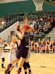 Alana Findley (with ball) scored 20 points in Fair