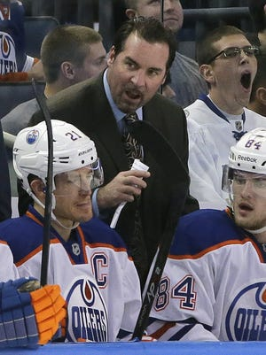 Edmonton Oilers coach Todd Nelson works during a game against the Tampa Bay Lightning on Jan. 15, 2015.