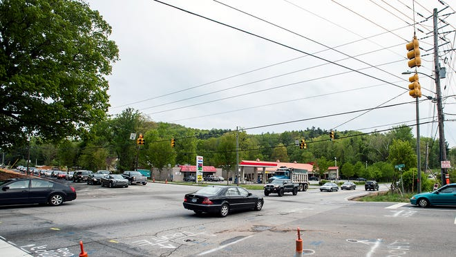 Traffic moves slowly through the intersection of Mills Gap and Sweeten Creek roads during rush hour.