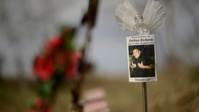 A picture of Joshua Richards, who was shot in the head in an Appleton bar in 2013, is displayed at a memorial site near his family home in Gillett on Friday, May 1, 2015. His organs, eyes and tissue are expected to help dozens of people.