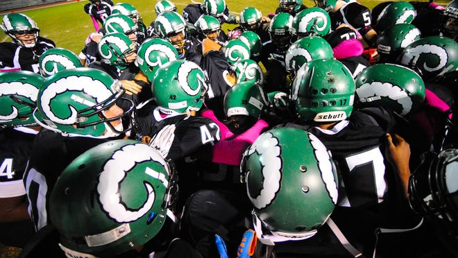 Parkside prepares to take the field from the second half against Snow Hill at County Stadium during the fall 2014 season.