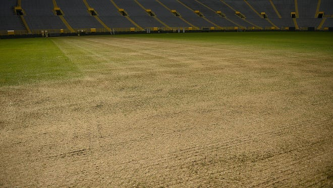 The condition of the playing field Monday after Saturday's Kenny Chesney and Jason Aldean concert at Lambeau Field.
