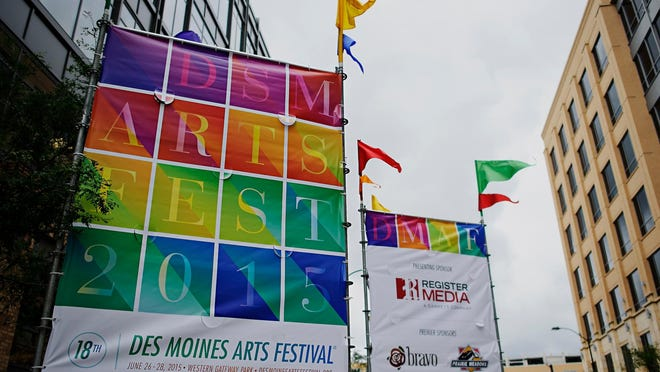 Banners mark the entrance to the Des Moines Art festival in Western Gateway Park on Friday, June 26, 2015.