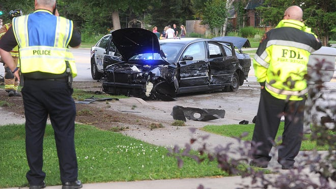 Fond du Lac Police respond to the scene of a crash on July 8 on East Johnson Street. A 16-year-old male was apprehended by K9 Packo after feeling the stolen vehicle.