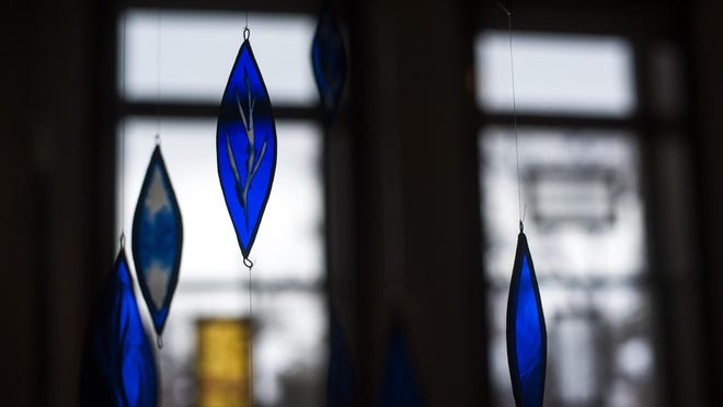 """""""Leaf Mobile"""" shows Kiki Renander's unique take on stained glass art. The piece is part of the """"Glass Forest"""" exhibit running through February at the Paris Gibson Square Museum of Art."""