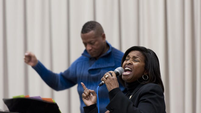 Evelyn Smiley rehearses a solo with members of the Tulare-Kings Counties Mass Choir rehearse at College of the Sequoias on Saturday, January 23, 2016. Director Charles Parker is in the background.