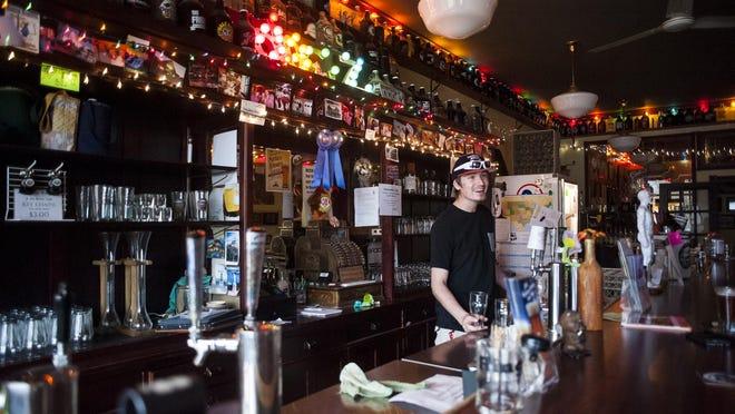 Zach Zilkoski pours a beer at Missouri Breaks Brewing in Wolf Point.