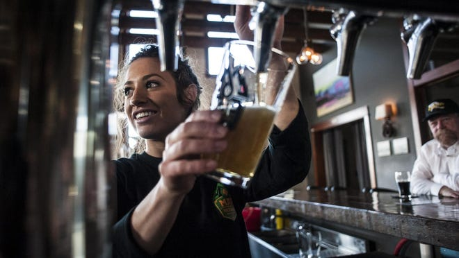 Ellen Asay pours a Northbound Golden at MAP Brewing in Bozeman.
