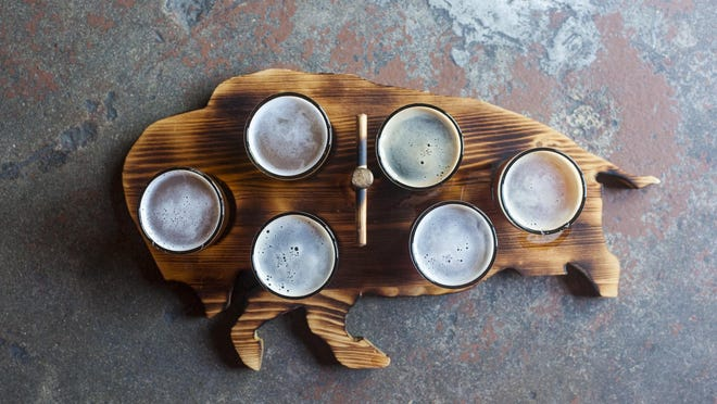 A bison-shaped flight board at Imagine Nation Brewing in Missoula. The stories of Montana's brewing industry are the focus of a new project at the Montana Historical Society.