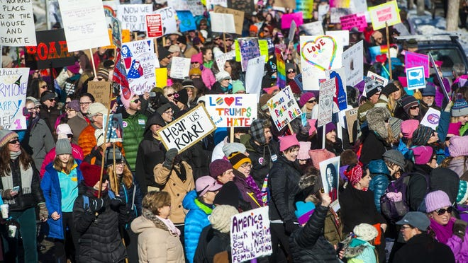 Participants fill Washington Street during the Women's March on Montana in Helena on Saturday.