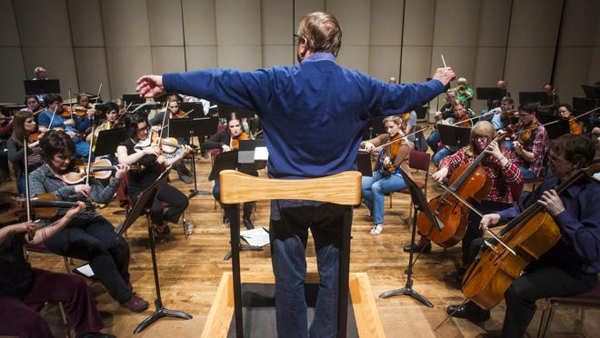 Gordon Johnson conducts the first rehearsal of his last performance with the Great Falls Symphony Orchestra in the Mansfield Theater Thursday, April 27. He is stepping down after working with the Symphony for 35 years.