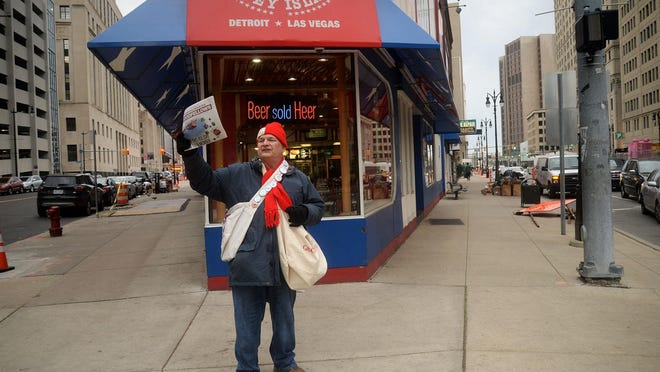 In this 2016 file photo, Goodfellow Richard Anderson, of Dearborn, attempts to sell Goodfellows newspapers during Sales Day 2016 for the Detroit Goodfellows on Griswold Street in Detroit.