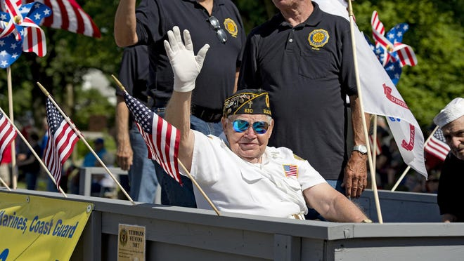 The Blue Ash Memorial Day Parade drew thousands of viewers on a beautiful Monday morning in 2017. Members of American Legion Post 630 parade down Cooper Road.