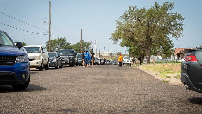 Vehicles lined several city streets as volunteers hand out lunches on one side of the building while volunteers on the other side hand out backpacks filled with school supplies during Saturday morning's school supplies distribution at the Black Historical Cultural Center.