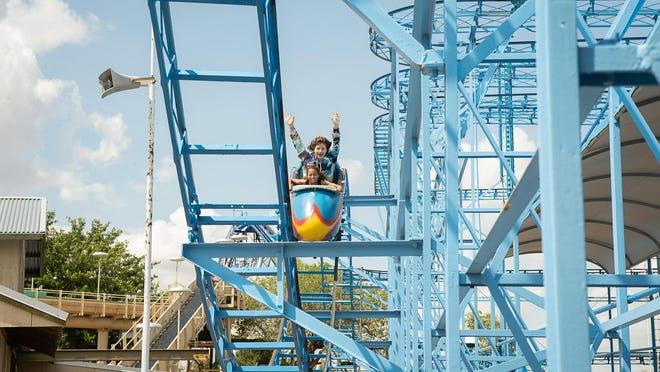 Zadie Calloway and Juliet Ballard ride on the Cyclone during Saturday's opening of Wonderland Amusement Park.