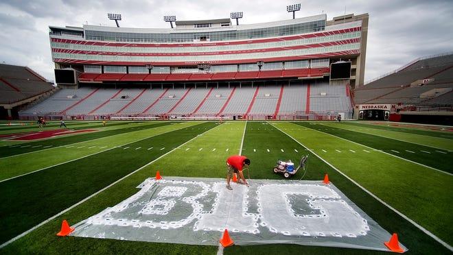 Field preparations will soon resume at Memorial Stadium in Lincoln, Nebraska, and other Big Ten football venues.