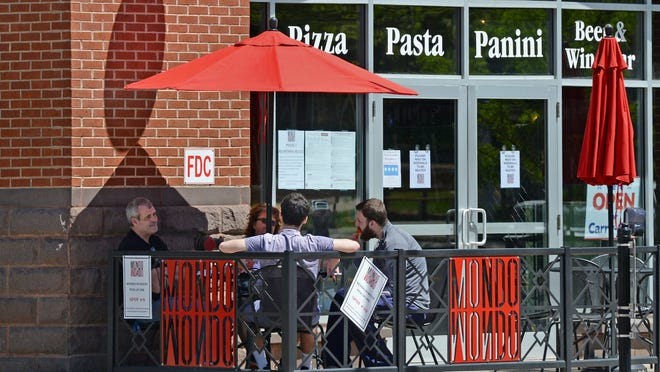 Diners enjoy a meal outdoors on the patio of a restaurant in Middletown this week.