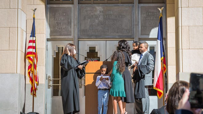 Titiana Frausto was sworn in Thursday afternoon as the judge of the 181st Judicial District Court. The ceremony was conducted by Judge Anna Estevez while Frausto's family assists.