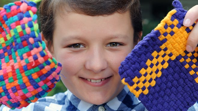 Grant Vereker, a fourth-grader at Woodland Elementary School in Milford, has been making potholders as a fundraiser to support local fire and police departments.