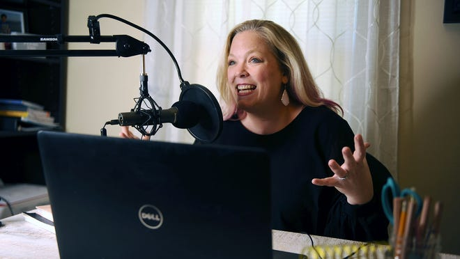 "Hudson resident Michelle Mercier, host of ""The Resilient Entrepeneur"" podcast, records a session in her home studio."