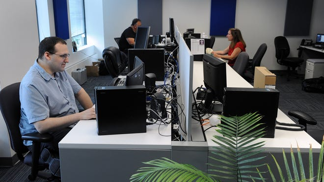 TCG Network Services employees work in their office on Superior Drive in Natick.