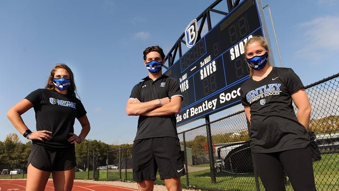 Bentley University freshman Angie Grabmeier, senior Brendan Hamblet and senior Emma Guccione pose for a picture on campus in Waltham on Friday. The trio of athletes play volleyball, ice hockey and soccer, respectively, for the Falcons but are waiting to see if they'll play their sports this school year.