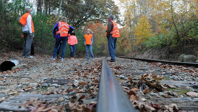 Hopedale residents who want the town to buy land that the railroad also wants to purchase meet up Tuesday at the Grafton and Upton Railroad tracks.