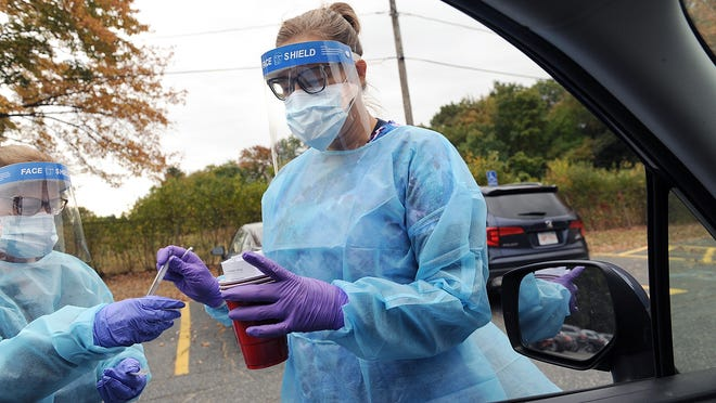 Registered Nurse Loren Prather prepares to give a COVID-19 test Friday at the Walsh Middle School, the newest  location for free drive-through COVID testing administered by Fallon Ambulance. The drive-through at 301 Brook St. is open Monday-Saturday, 9 a.m. to 1 p.m.  Free walk-up tests are available at South Middlesex Opportunity Council (SMOC) 7 Bishop St. Monday, Wednesday and Friday, 3-6 p.m., and at atac Downtown Arts + Music (formerly Amazing Things Art Center), 160 Hollis St., Tuesday and Thursday, 3-6 p.m.