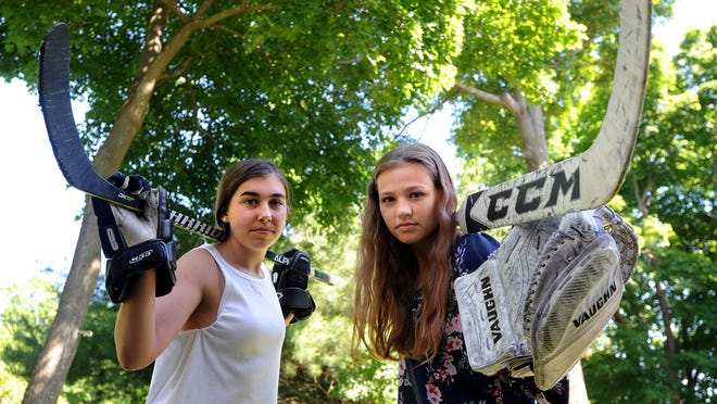Lana Pacific, right, Algonquin girls hockey starting goalie, with her friend and teammate, Jill Johannes, of Hudson.
