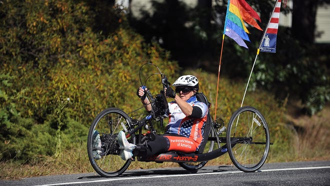 Debra Freed puts in 20 miles a day on her Force-3 handcycle, taking part in several virtual races with the Paralyzed Veterans of America. Here she is pictured on Dr. Harvey Cushing Way in Framingham.