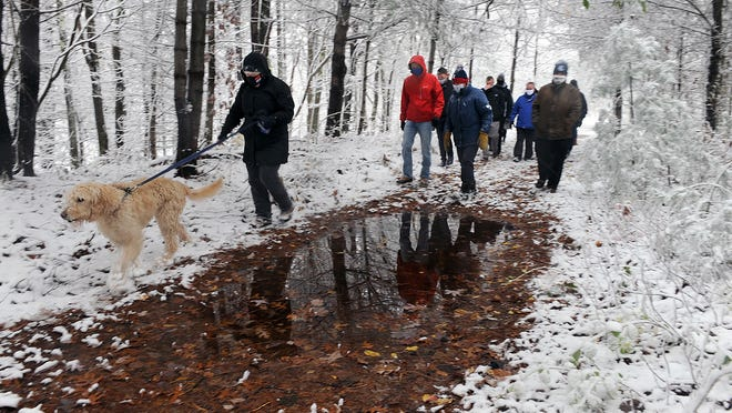 The Southern New England Trunkline Trail tunnel in Franklin was celebrated Friday morning with speeches and a ribbon cutting.   Supporters, town and state officials hiked along the trail, here led by State Sen. Becca Rausch and her dog, Bailey.