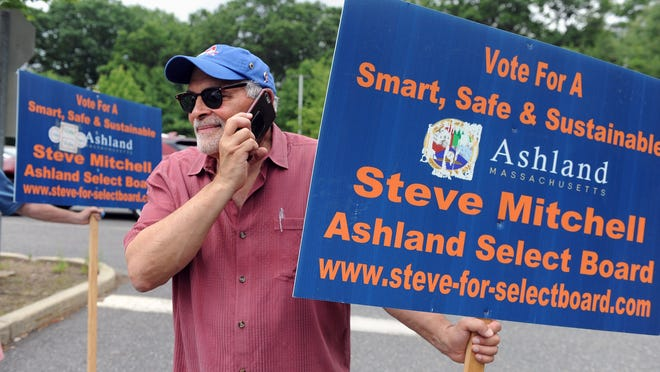 Ashland Select Board member Steve Mitchell campaigns outside Ashland High School on Wednesday. In the day's only contested race, Mitchell won his fourth term on the Select Board by defeating Preston Crow.