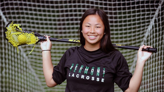 Lily Trainor, a University of Vermont sophomore in the fall, in front of her backyard lacrosse net Monday. She was a record-setting standout lacrosse player at Holliston High School.