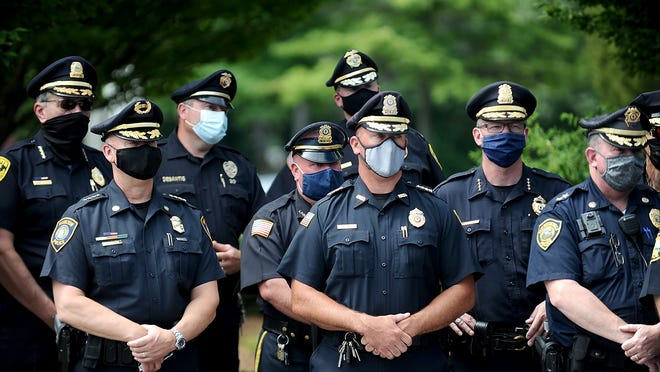 Dozens of police chiefs attended a rally on July 21 addressing proposed state police reform bills. The rally was held at an otherwise empty AMC Movie theater parking lot in Framingham.