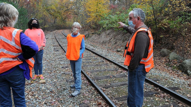 Hopedale residents gather at the Grafton and Upton Railroad tracks last month.