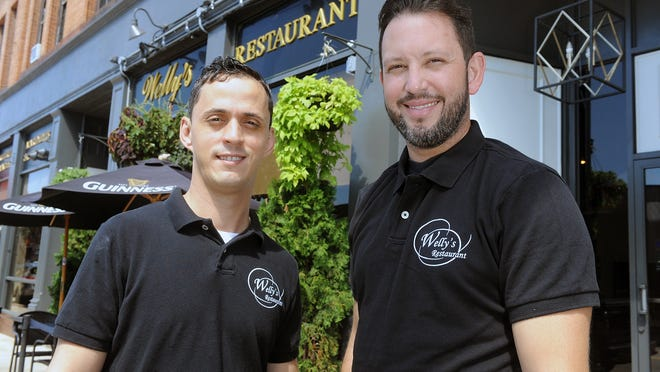Welly's Restaurant owners Wemerson Vieira, left, and Wellington DePinho. The restaurant is one of 20 in Marlborough to participate in the Marlborough Economic Development Corp.'s Dine Local program.