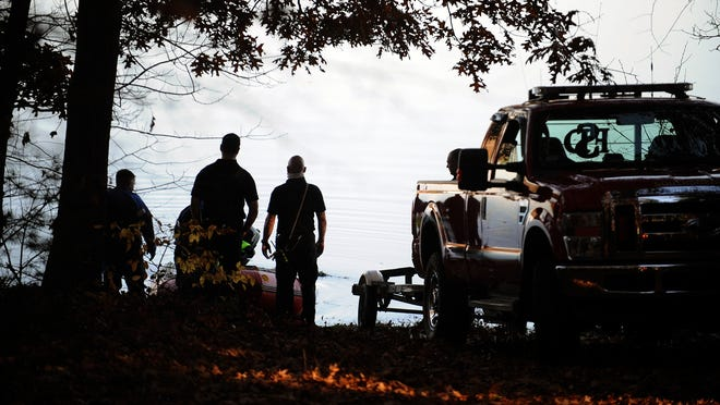Southborough firefighters  and Framingham Dive Team members enter the Sudbury Reservoir  from White Bagley Road late Monday morning, Nov. 9, 2020.