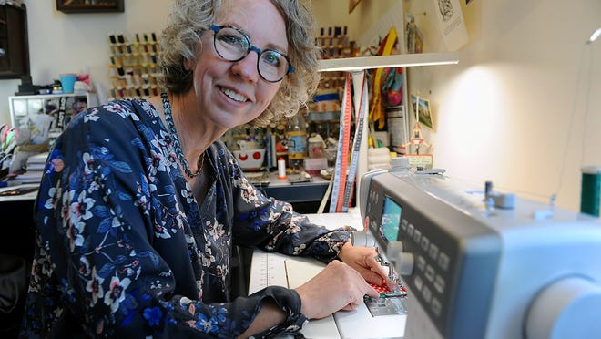 Fairbanks Fancy Goods owner Julie Vician at work at her business at 2 Summer St. in Natick.