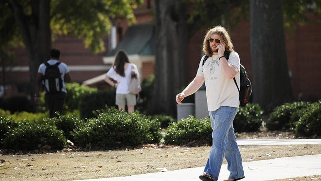 An Augusta University student talks on his cell phone at the Summerville Campus. Technology that tracks a cell phone's location is being used by a Birmingham, Ala., company to analyze traffic patterns in the urban core with the goal of attracting new retail and restaurants. Only the phone's location is pinged, not information about the person.