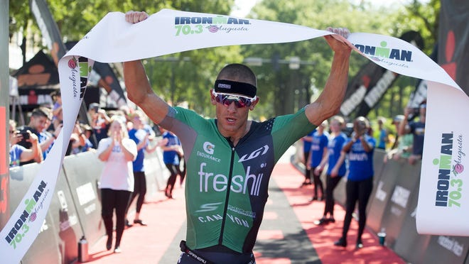 Lionel Sanders wins the men's division of the Ironman Augusta 70.3 in this file image from 2019. Ironman events nationwide have been canceled because of the COVID-19 pandemic. The organization is expected to make an official announcement in the coming days.