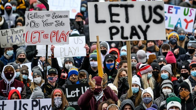 "Student athletes, coaches and family participate in the ""Let Them Play"" rally on Saturday, Jan. 30, 2021, at the Capitol in Lansing. The rally was aimed at getting high school athletes back in action for winter sports."