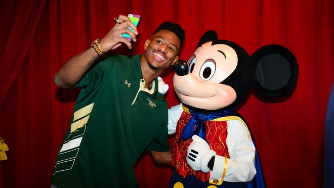 CSU wide receiver Rashard Higgins and Mickey Mouse take a selfie during the 2014 College Football Awards.