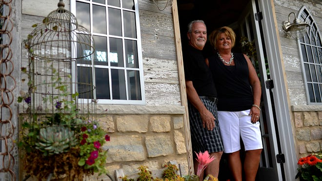 """Pat Staszak and Lori Tatar-Staszak built their potting shed themselves as a conversation piece in their """"shabby-chic'' gardens on Green Bay's east side. Amenities include a ceiling fan, piped-in music and decorations that change with the seasons."""