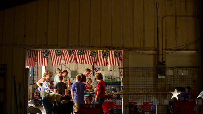 People admire the rabbits at the Brown County Fair in De Pere.