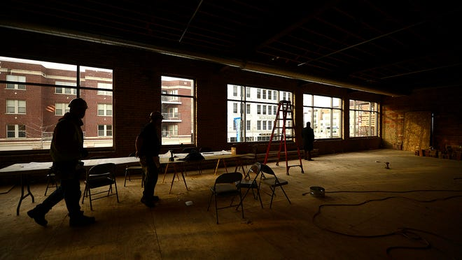 Construction continues Wednesday on the office space for Breakthrough Fuel at the Meyer Theatre in downtown Green Bay.