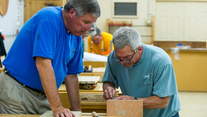 Jeff Headley, Berryville, Virginia, right, a fourth-generation cabinetmaker, is one of two instructors for the Shenandoah Valley Tall Case Clock, where they assist students, like Raymond Dusman, Fort Wayne, with their projects. Woodworking students from around the globe travel to Franklin to learn from the best craftsman at Marc Adams School of Woodworking. Three separate classes were at work on Monday, April 28, 2014.